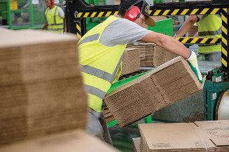 Worker stacking boxes