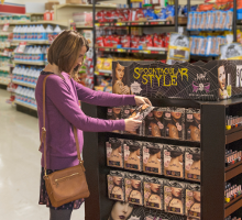 Woman looking at retail display in store