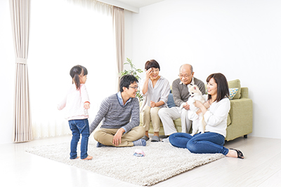 family in living room with dog