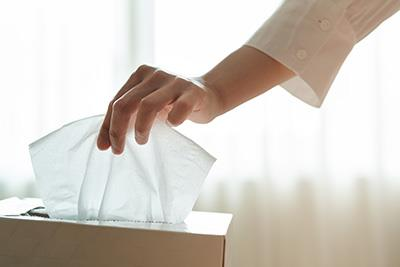 pulling tissue out of box
